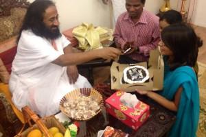 Aashna celebrating her birthday with Sri Sri