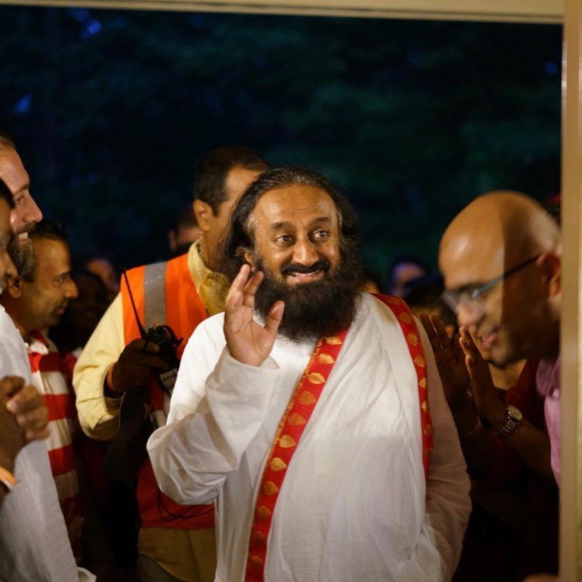 Gurudev Sri Sri Ravi Shankar smiling at a devotee at The Art of Living International Center