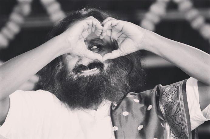 Gurudev Sri Sri Ravi Shankar greeting the audience with hands folded